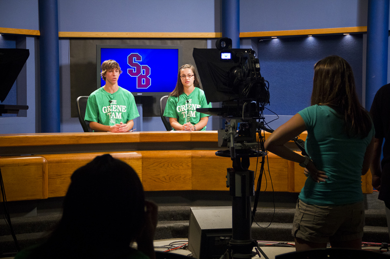 Greene Team members Ian Berry and Brittany Garguilo try their hand at anchoring a newscast Wednesday, July 27, 2011 at the Stony Brook University School of Journalism TV studio. / Photo by Wasim Ahmad