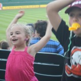 James Reilly and his sister dance before a game between Long Island Ducks and Southern Maryland Blue Crabs on Tuesday, July 24, 2012. Photo by Hannah Fagin