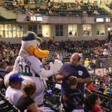 Long Island Ducks mascot QuackerJack high-fives a fan. (July 24, 2012) Photo by Glenda Sanchez