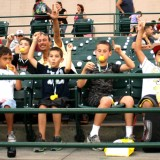 Young fans of the Long Island Ducks cheer on their home team on July 24, 2012 at Bethpage Ballpark. Photo by Matthew Maron