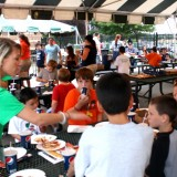 Sarah Schreiner of the Greene Team interviews young Long Island Ducks fans as they enjoy refreshments during the game on July 24. 2012 at Bethpage Ballpark. Photo by Matthew Maron