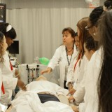 HCOP students are given hands-on experience using a dummy on July 25, 2012. Photo by Matthew Maron