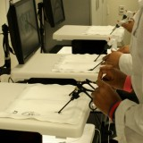 HCOP students practice Laparoscopic techniques on July 25, 2012. Photo by Matthew Maron