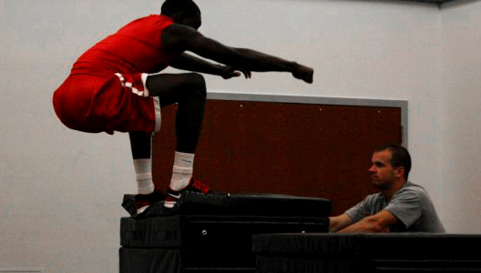 the Stony Brook mens Basketball warms up their muscles for their workout. Photo by Liza Bell