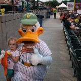 QuackerJack and a fan on july 24, 2012 at Bethpage Ballpark. Photo by Lyla Dale