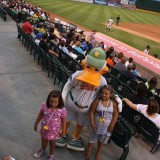 QuakerJack poses with young fans on July 24, 2012 at Bethpage Ballpark.Stadium-goers can buy plastic duckbill noisemakers that imitate the trademark sound of their favorite mascot. Photo by Lyla Dale