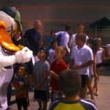 Fans wait in line for a baseball signed by QuackerJack onJuly 24, 2012 at Bethpage Ballpark. Photo by Lyla Dale