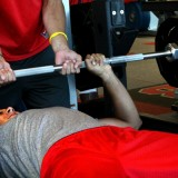 A Stony Brook University athlete excercises using the bench press on July 25, 2012, at the new Stony Brook University Dubin Center. Photo by Alexandra Henaghan