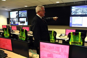 Chief of Police, Robert Lenahan talking about the televisions in the command center that show different maps and security cameras around campus. (Jacqueline Napolitano)