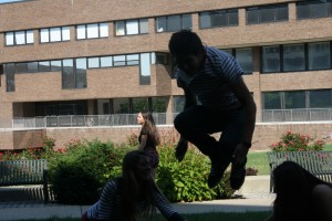 ACtion Shot Alejandro jumps over Madison  and Noelia